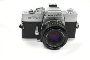 minolta 35mm film camera on a white background