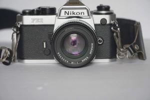 nikon 35mm film camera on a white background