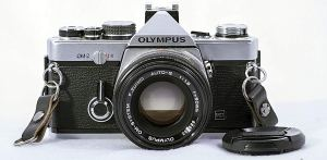 olympus 35mm film camera on a white background