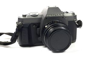 pentax 35mm film camera on a white background