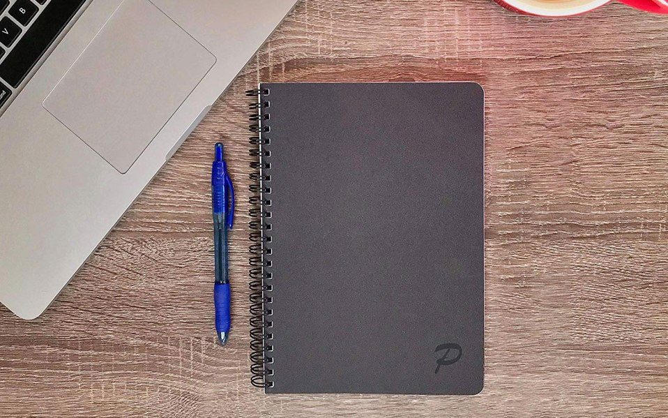 a goal tracking notebook sitting on