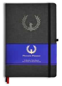 the phoenix goal tracking journal on a white background