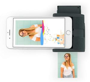 a prynt pocket mini printer attached to the bottom of an iphone and printing out a photo of a girl in a white shirt with glasses on
