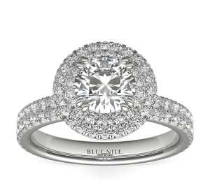 double halo diamond engagement ring on a white background