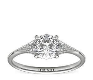 heirloom understated diamond engagement ring on a white background