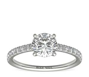 french pave diamond engagement ring on a white background