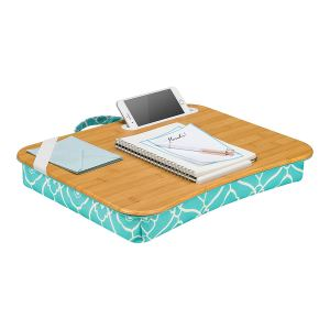 a tea lapgear cushioned bed tray table holding anotebook and phone sitting on a flat surface on a white background