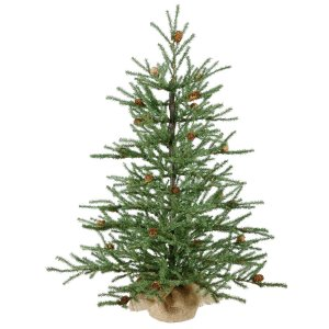 small short artificial christmas tree on a white background