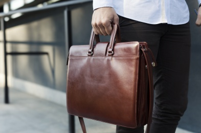 Holding briefcase