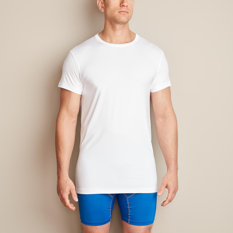 Man wears white Duluth Trading Men's Armachillo Cooling Undershirt