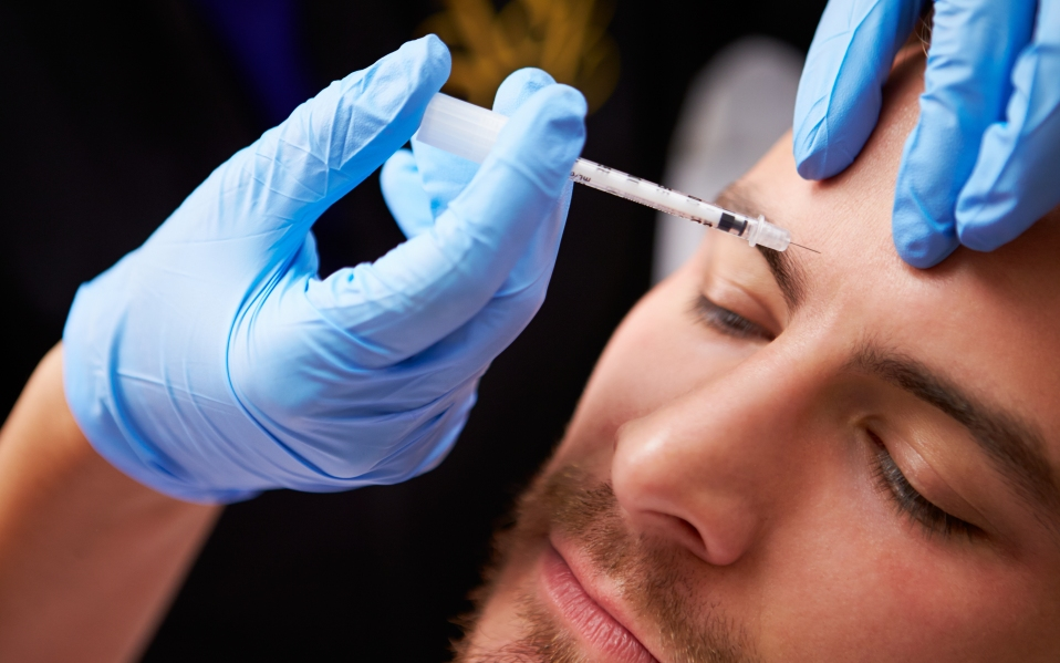 Man Having Botox Treatment At Beauty
