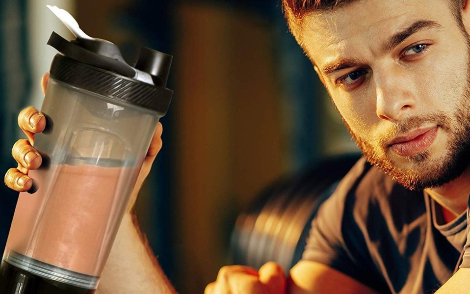 guy holding protein blender shaker (featured