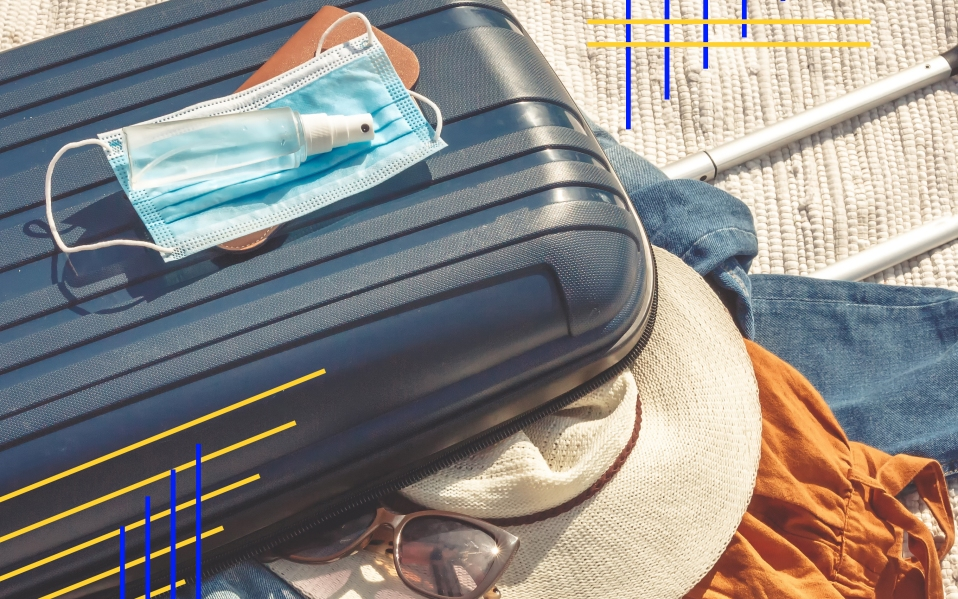 Travel.Todler sits near a suitcase with