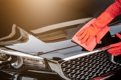 Car wash cleaning concepts . Auto service staff cleaning car with microfiber cloth in Interior car console
