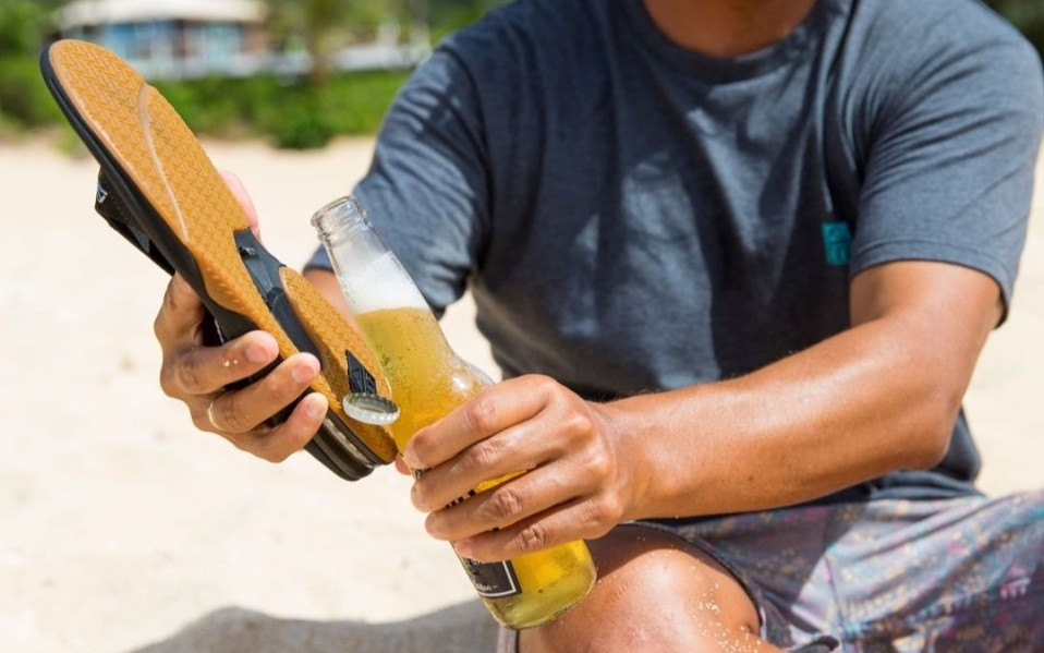 man opens beer with reef mens