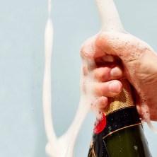 man shaking champagne bottle
