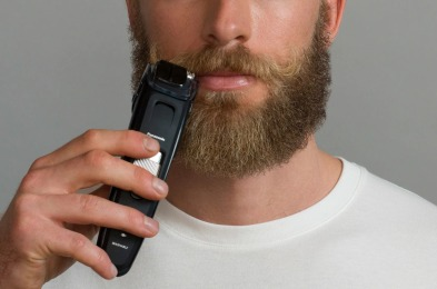 Men trimming a beard