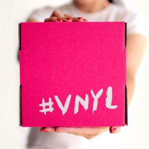VNYL logo on a pink background, vinyl records subscription service