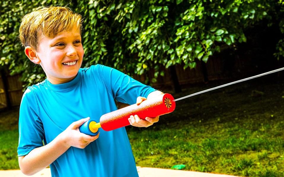 Kid Shooting Water Gun