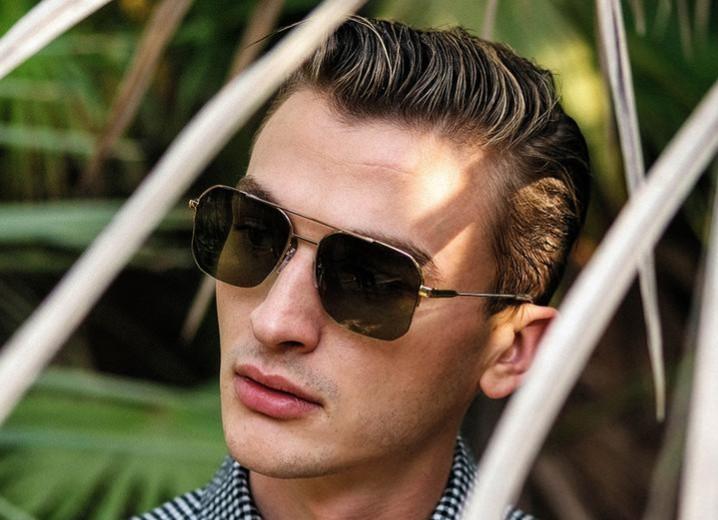 Man wearing RAEN Munro aviator sunglasses