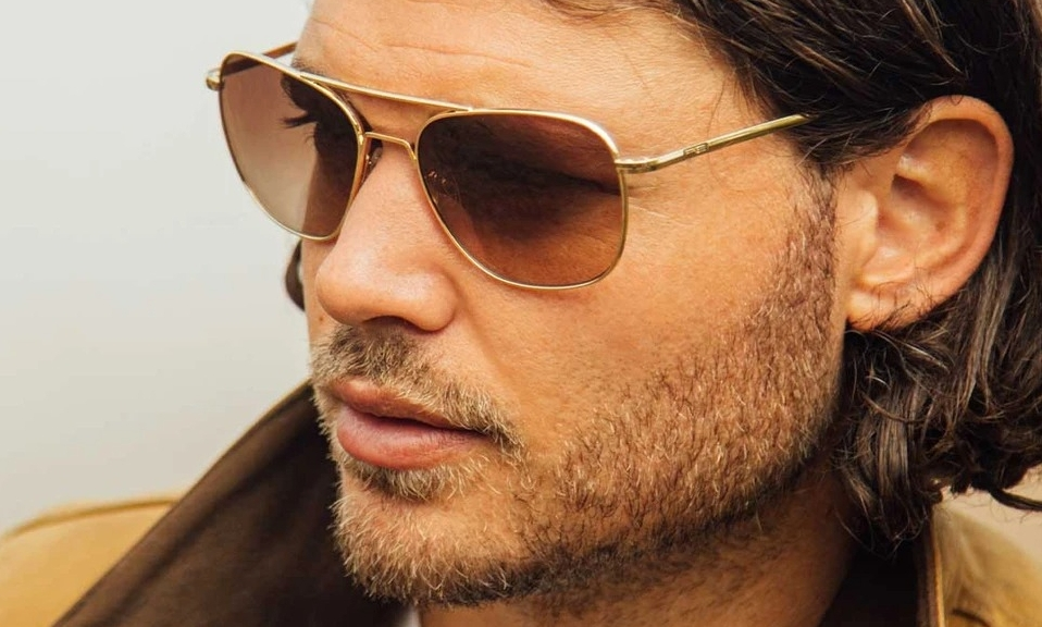 Man wears Randolph aviator sunglasses