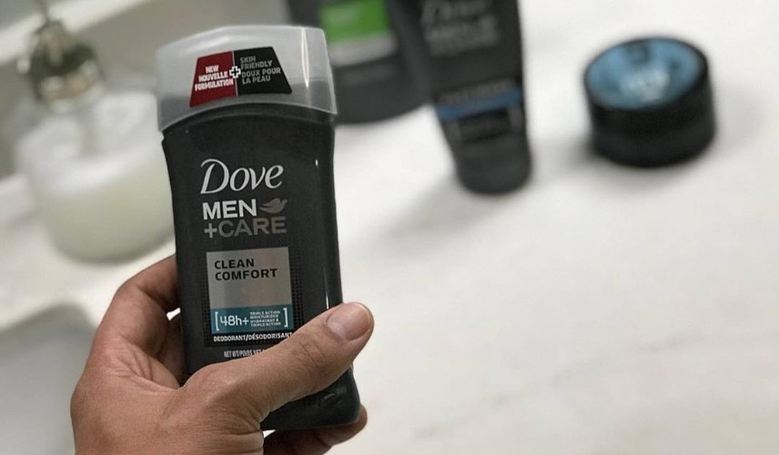 Dove men+care antiperspirant deodorant, held in
