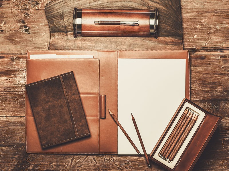 Luxurious writing tools on a wooden