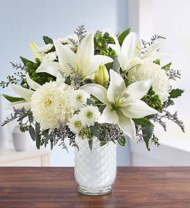 pure elegance bouquet ( with white Asiatic lilies, football mums, button poms; purple limonium; green hypericum; seeded eucalyptus and assorted greenery), flower delivery services
