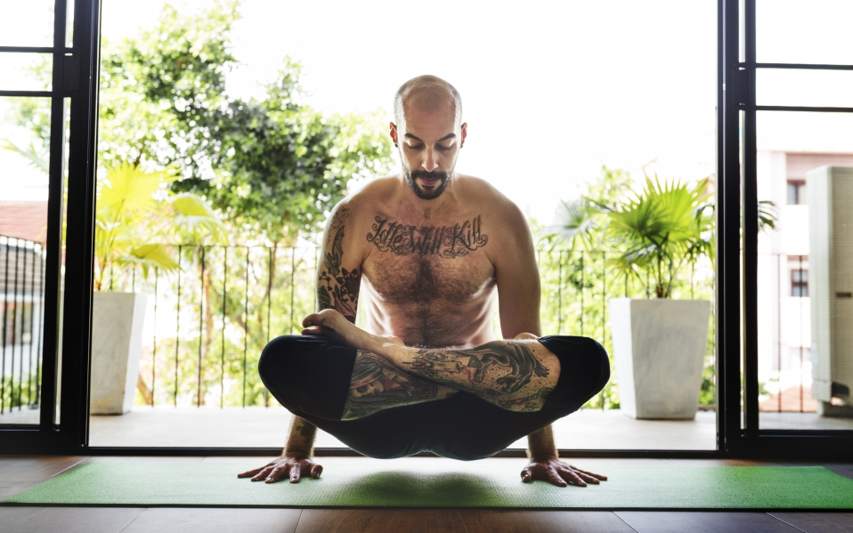 man doing yoga pose with open