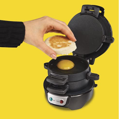 hand cooking egg in hamilton beach breakfast sandwich maker