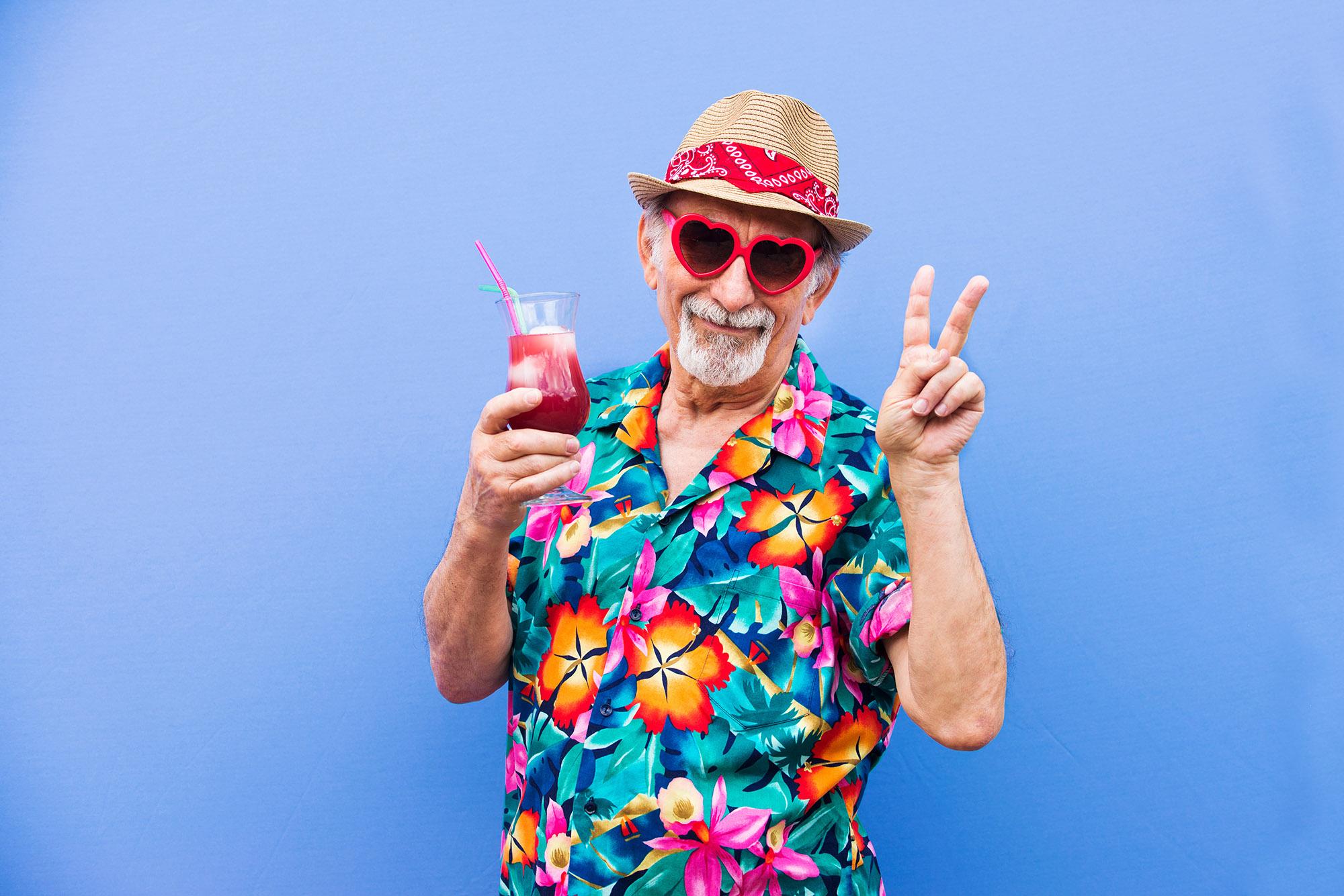 senior man wearing fun hawaiian shirt