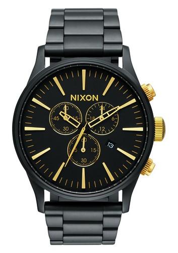 Nixon black and gold chronograph watch