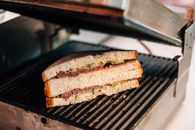 sandwich going into panini press