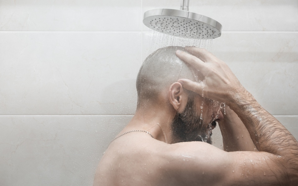 A man washes in the shower.