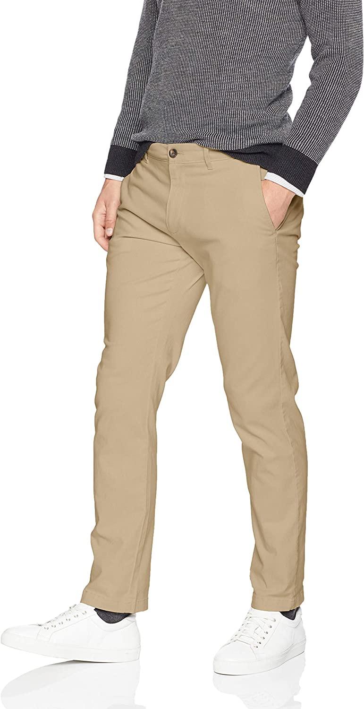Man wears Amazon Essentials Men's Slim Fit Casual Stretch Khaki pants