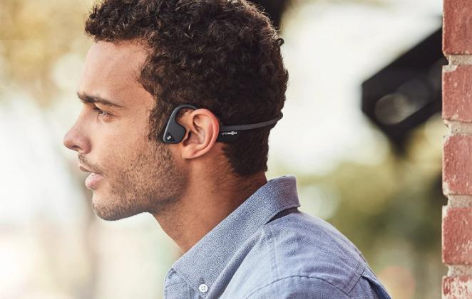 guy wearing bone conduction headphones