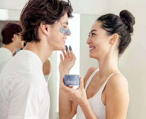 woman applying disco skin care mask