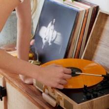 Girl putting on Billie Eilish Record