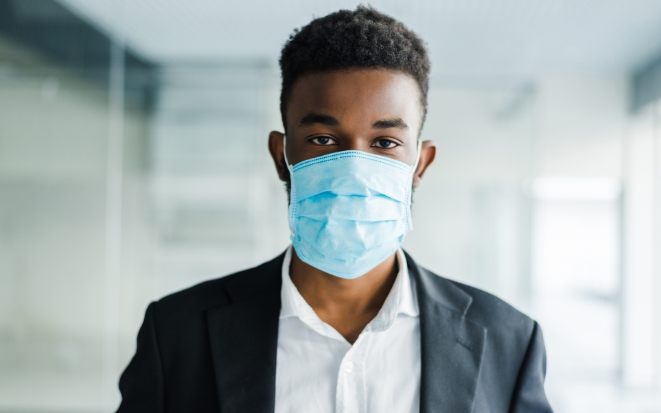 African man in medical mask on
