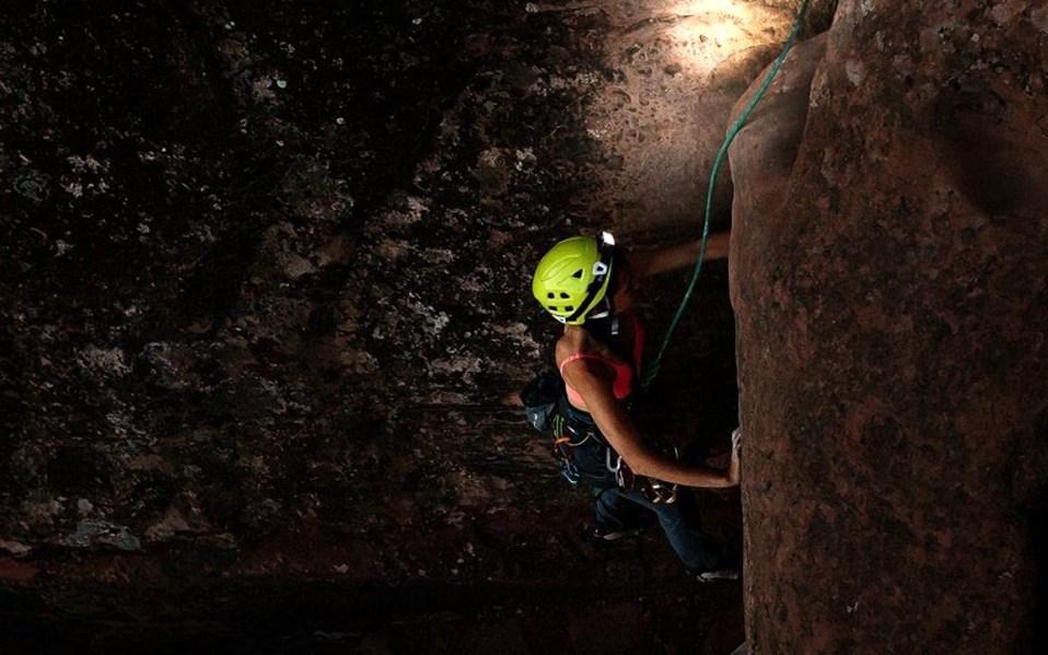 Woman rock climbs with BioLite Headlamp