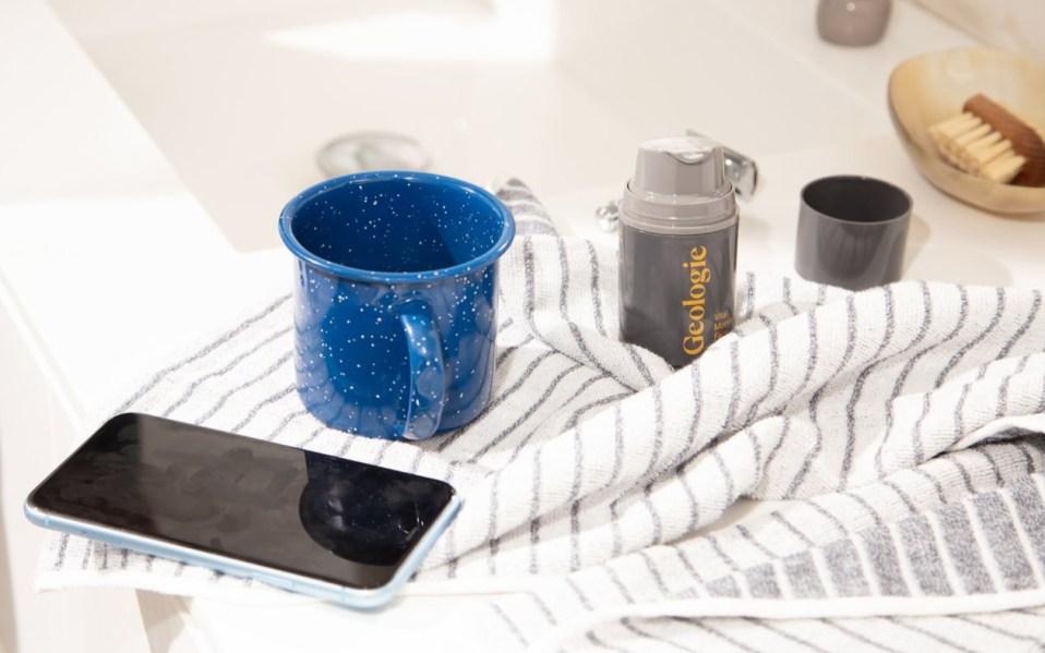 phone, mug and Geologie skincare product