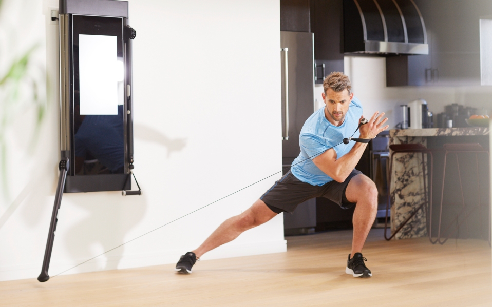 Man exercises using Tonal Home Gym