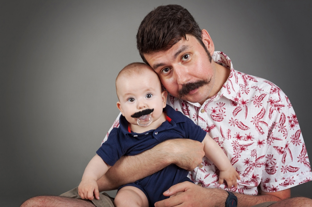 man and a baby wearing mustache