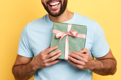 handsome bearded overjoyed man is happy to receive a gift