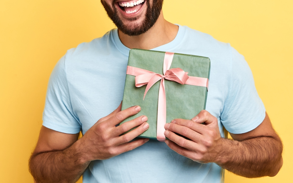 handsome bearded overjoyed man holding a