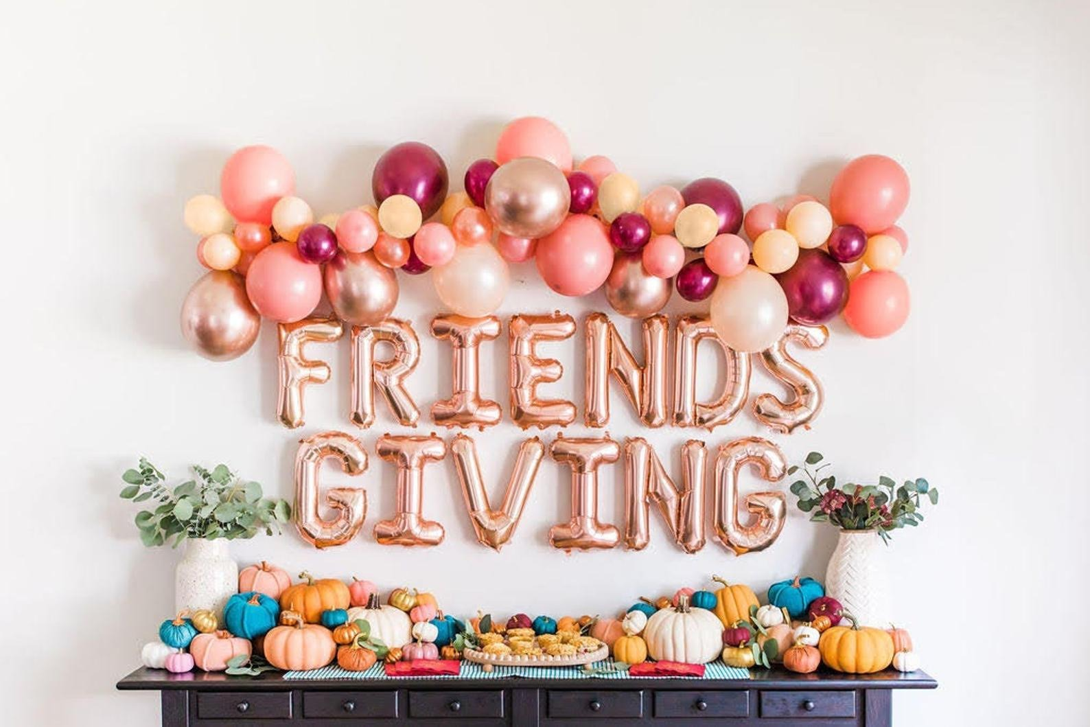 thanksgiving decorations - friends giving balloon garland in pink, white, purple and Burgundy