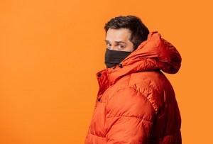 man wearing orange puffer jackets, men's puffer jackets 2021