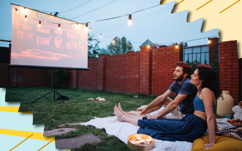 couple watching movie on projector