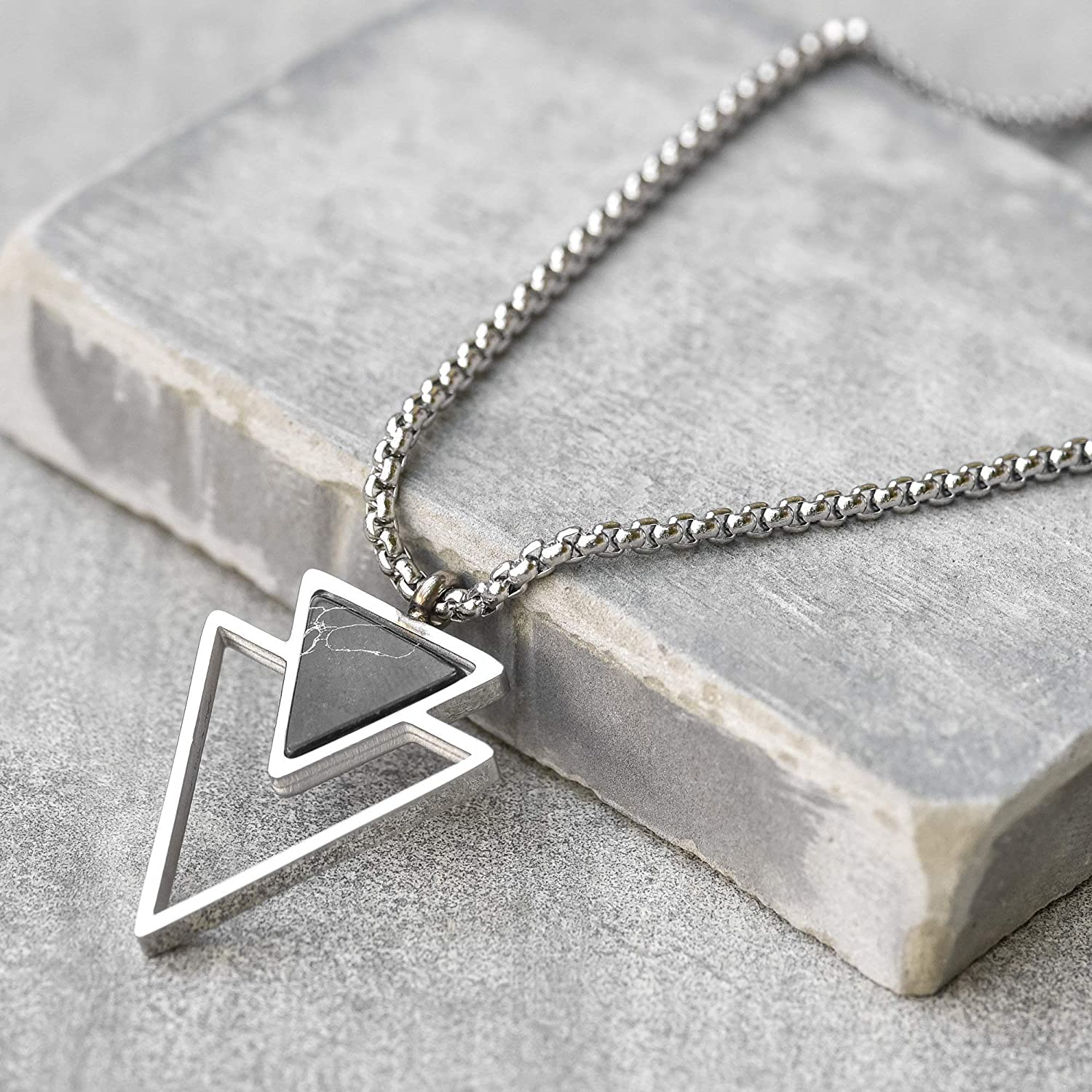 silver triangle pendant with black stone insert