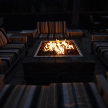 Tiltshift image of a fire pit and outdoor seating